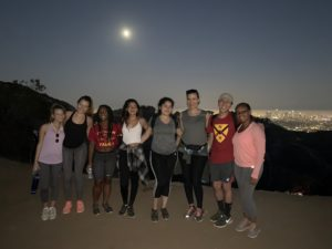Photo of group hiking in the evening